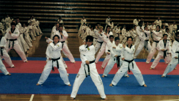 Andre Conate at one of many Taekwondo event. In traditional Dobok (uniform) and martial arts stances.
