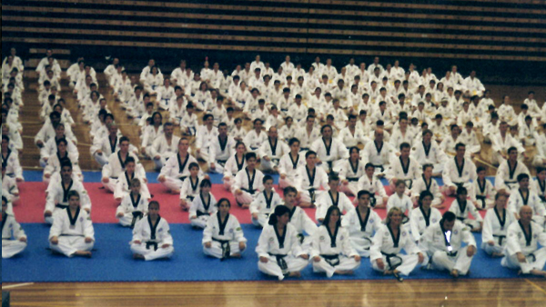 Andre Conate at one of many Taekwondo events. At the front with other top instructors.